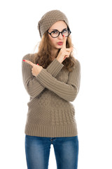 Girl in a beige sweater showing thumb to the side. Warning, adve