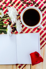 romantic mug of coffee and daisy on striped napkin
