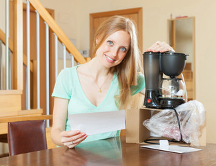 Woman with new electric coffee maker