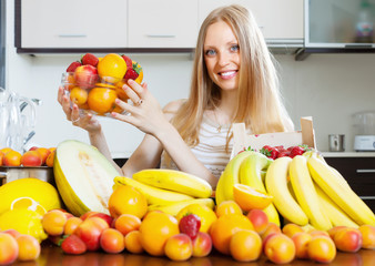 girl holding  fruits in home