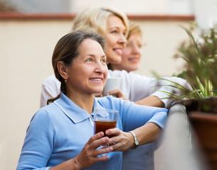 Woman friends on summer terrace