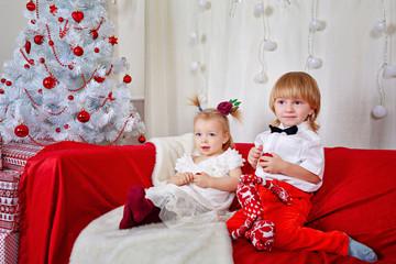 Brother and sister awaiting Christmas