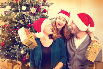 Parents with teenage daughter at home celebrating New Year