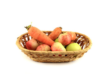 Basket with vegetables and fruits. Isolated object on white back