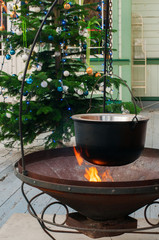 preparation of mulled wine on the fire