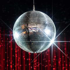 Silver disco ball with stars in nightclub