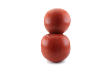 Two red ripe tomatoes. Isolated object on white background.