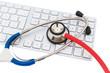 Stethoskop und Tastatur eines Computers