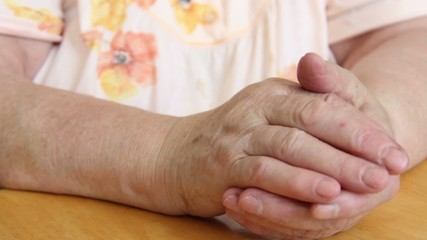 Painful old woman's hands.
