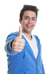 Junger Mann im blauen Pulli zeigt den Daumen