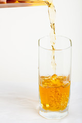 apple juice pouring into a glass