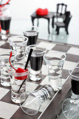 Chess board with shot glasses