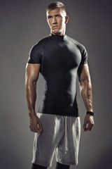 Portrait of young muscular trainer