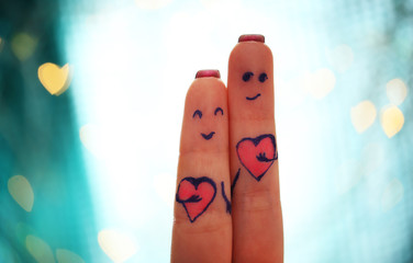 Lovers fingers on bokeh background