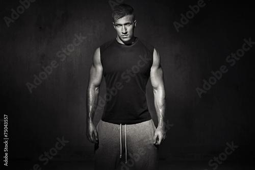 Black&white portrait of muscular athlete