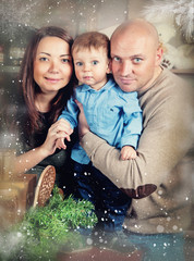 Christmas portrait of a young family