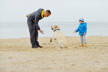 family with dog on the beach