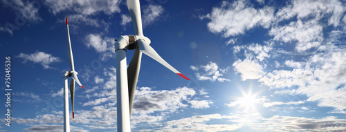 Leinwanddruck Bild energy wind turbines and sky with clouds