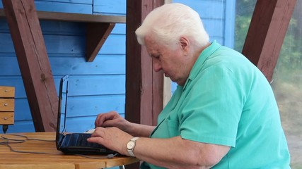 Old woman have problem with her laptop computer