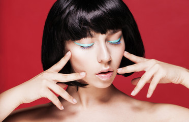 Glamourous closeup female portrait. Fashion eyeliner makeup on