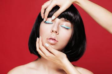 Glamourous closeup asian female portrait. Fashion eyeliner