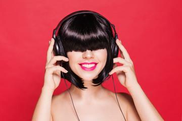 Woman listening to music on headphones enjoying a dance. Closeup