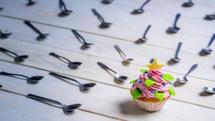 Muffin surrounded by teaspoon