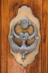 Old iron knocker on an old metal door in the Spain