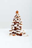 The hand-made eatable gingerbread New Year Tree with snow decora poster