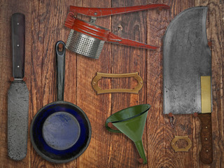 vintage kitchen utensils over wooden wall