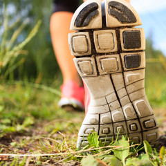 Walking or running legs in forest, adventure and exercising