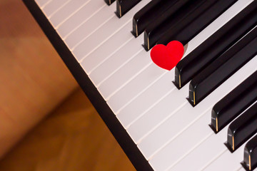 Red heart over piano keyboard