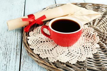 Cup of coffee with lace doily and roll paper
