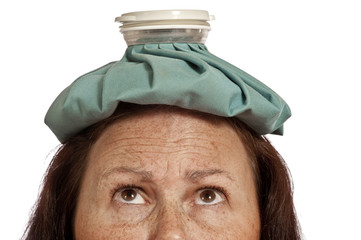 Woman's Forehead With Ice pack For Headache