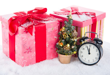 Clock with christmas tree and presents on snow