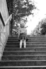Portrait of a child on the steps of black-and-white