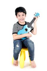 Little asian child with akulele