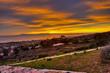 Hillside V under a fiery sky