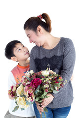 Little asian child with bouquet in hand and mother