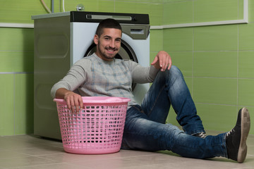 Handsome Smiling Man In The Laundry Room