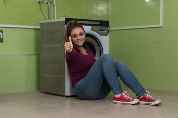 Pretty Smiling Girl In The Laundry Room