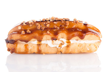 Eclair with caramel decoration
