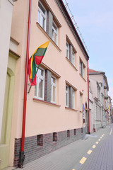 Klaipeda, Lithuania, 2014: on the house hanging  national flag