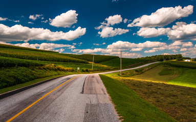 Beautiful summer clouds over a country road in rural York County
