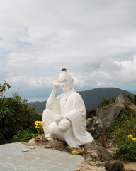 White statue on top of the hill