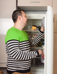guy   near  refrigerator  at home