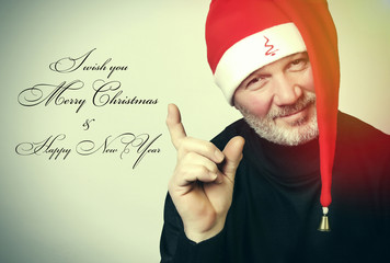 Man with beard and christmas hat wishing happy holidays