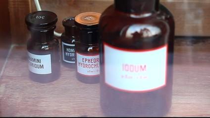 Pharmacy showcase vintage bottles drugs