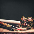 Vintage grungy still life with carnival mask, old parchment and