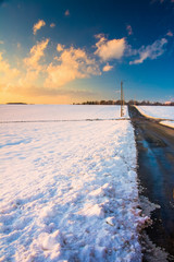 Country road and snow covered fields at sunset, in rural York Co